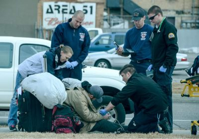 (Francisco Kjolseth The Salt Lake Tribune) Paramedics attend to a homeless man in Salt Lake City on Tuesday. A recent poll story on homelessness tries to answer the questions surrounding funding and responsibility.
